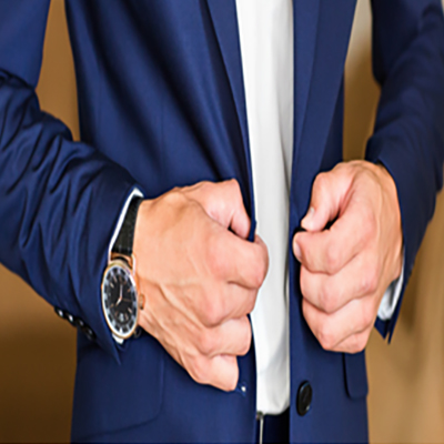 Stylish gent buttoning his jacket, with a sport watch on his wrist
